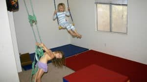 Sensory room ideas with gymnastics mats, bars and hanging ropes