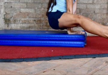 straddle press on gymnastics mats
